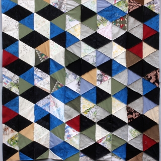 Treadle to the Metal. 2015.  First in a series of 7 ft. modular panels. Recycled fabric using treadle sewing machine.